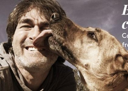 """Man """"getting kisses"""" from dog"""